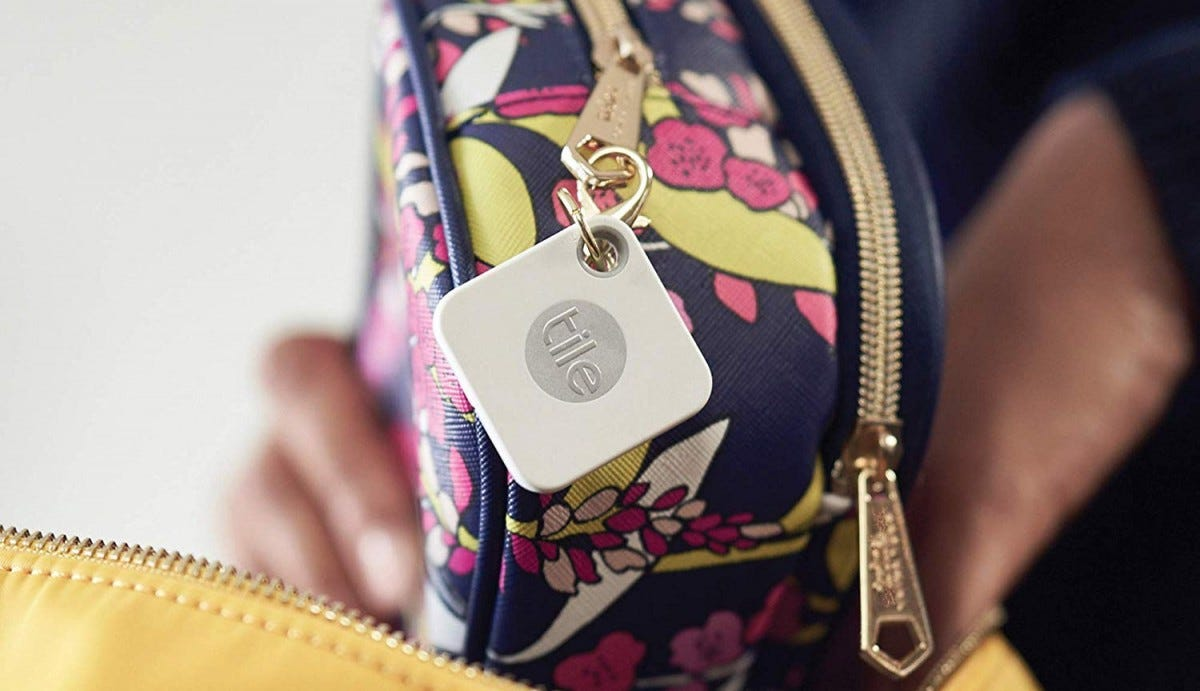 A Tile Mate tracker attached to a purse.