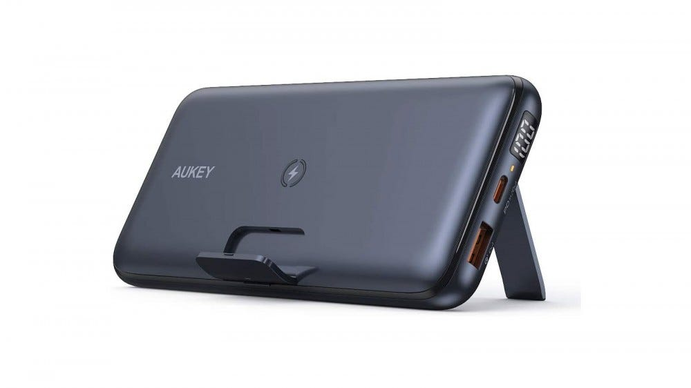 A wireless charging battery propped up on a kickstand.