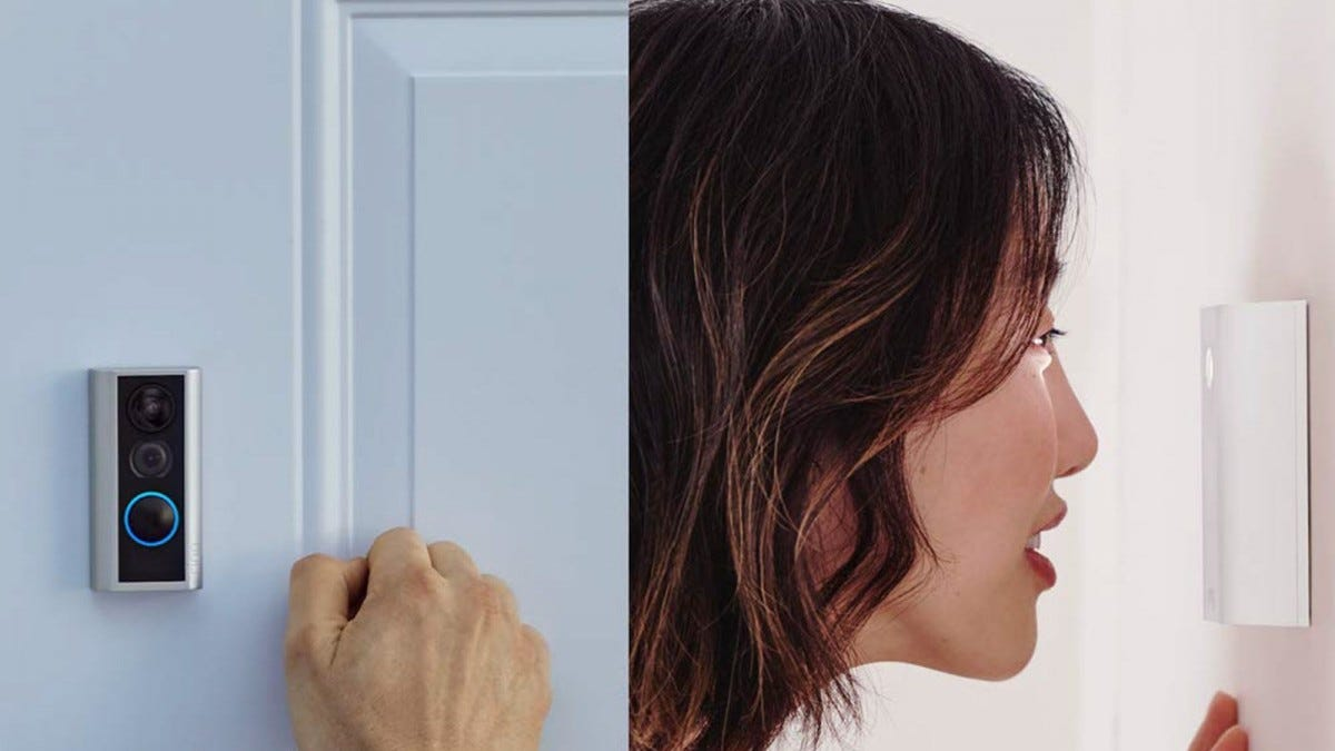 A Ring Peephole camera mounted to a door, with someone looking through it.