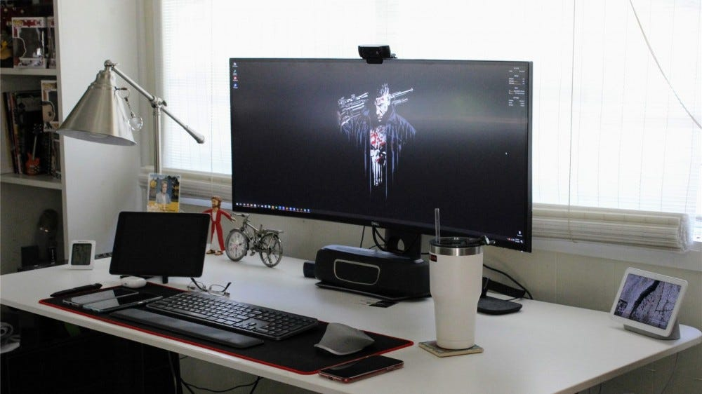 My desk, complete with a massive 38-inch ultrawide monitor