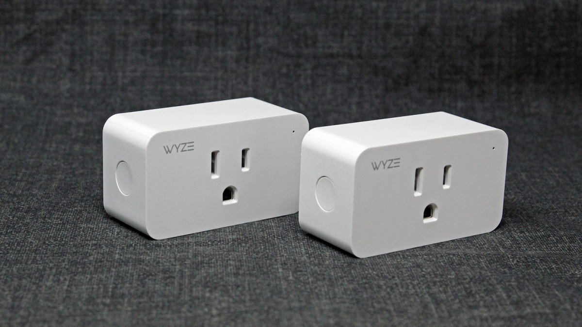 Two Wyze plugs at an angle, showing their power switch.