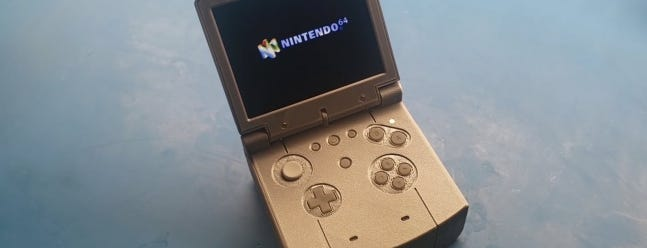 Image of article 'A YouTube Modder Stuffed an N64 Into an Oversized Game Boy Advanced Case'
